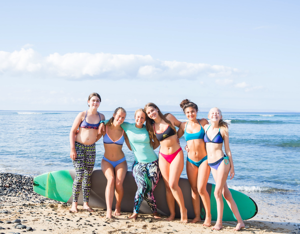 Gina Mills (green rash guard, center) with her surf pod for Week 2