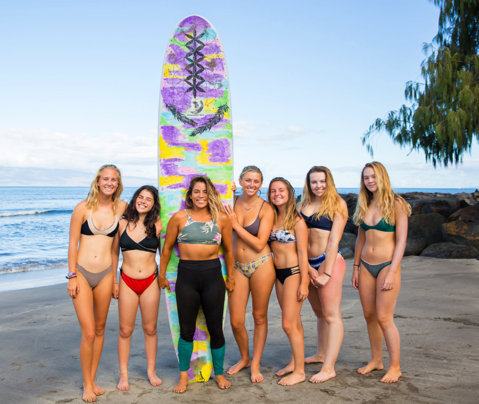 Kiki Martins (center, black leggings) with her pod for Week 2