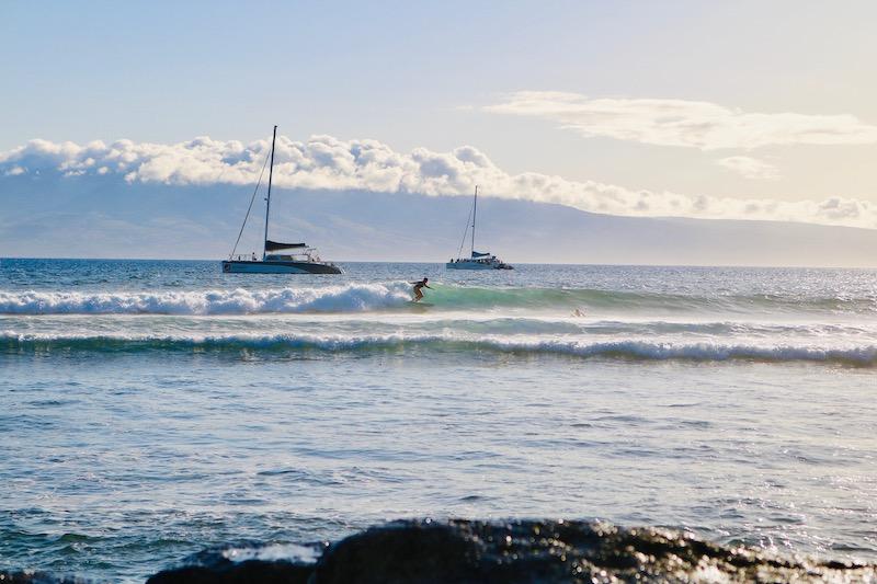 raye surfs Lahaina Breakwall photographer Gina Sierra