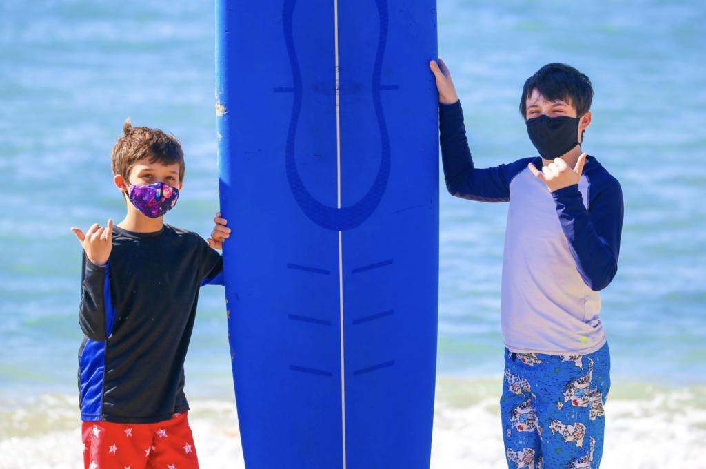 Travel to Maui 2021  How to Travel to Maui 2021  Boys Wearing Masks on the Beach on Maui